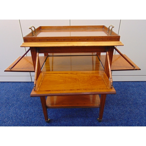 8 - A rectangular French mahogany tea tray table with satinwood inlaid bands and hinged sides, on four t...
