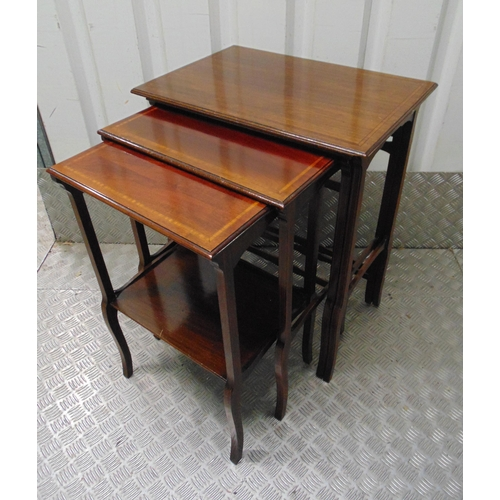 9 - A nest of four mahogany tables with satinwood banding on tapering rectangular legs, 69 x 55 x 37.cm