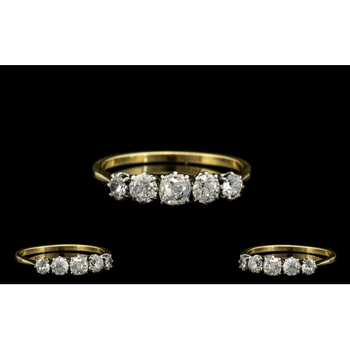 16 - 18ct Gold and Platinum - Attractive 5 Stone Diamond Ring. c.1920's. The Old Round Brilliant Diamonds...