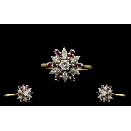 18 - 18ct Gold Diamond and Ruby Set Ladies Ring of starburst design. Marked 750-18ct. The marquise shaped...