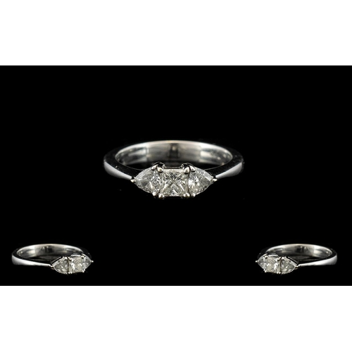 28 - 18ct White Gold And Diamond Three Stone Ring Set with central princess cut between two trillion cuts...