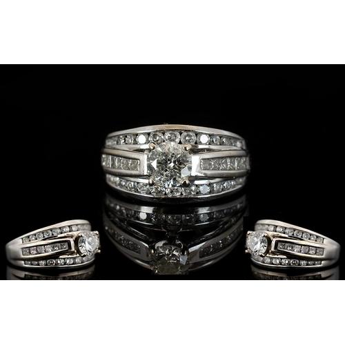 37 - 18 Carat White Gold Princess and Brilliant Cut Diamond 3 Row Dress Ring full 18 carat gold hallmark....
