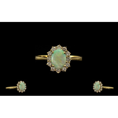 42 - Ladies Attractive 18ct Gold Opal and Diamond Dress Ring. Fully Marked for 750 - 18ct. The Central Ov...
