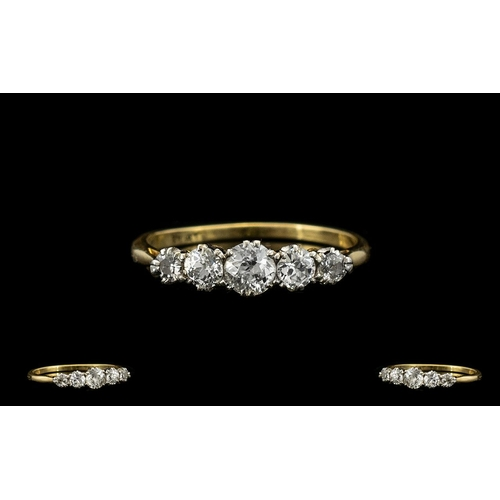 48 - 18ct Gold and Platinum Set Attractive 5 Stone Diamond Ring. c.1920's. Marked 18ct Gold and Platinum....