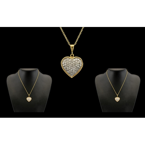 8 - 18ct Gold Heart Shaped Diamond Set Pendant Attached to a 18ct Gold Chain, The Whole Making a Very Pl...