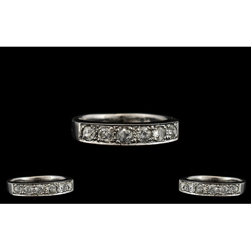 10 - 18ct White Gold - Quality and Pleasing Seven Stone Diamond Ring. Fully Hallmarked for 18ct - 750. Th...