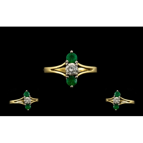 15A - 18ct Gold Attractive Emerald and Diamond Set Dress Ring - Well Designed. The Central Brilliant Cut D...