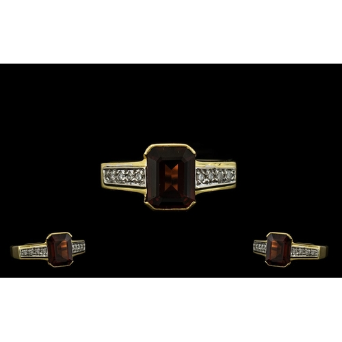 32 - 18ct Gold Garnet and Diamond Set Ring of Attractive Form. The Central Emerald Cut Garnets of Good Ri...
