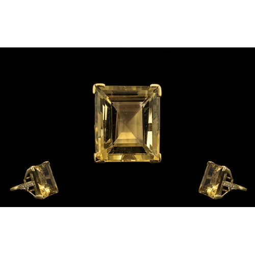 38A - A Superb and Impressive Large Step Cut Topaz Set In a Gold Shank, with Diamond shoulders. The Citrin...