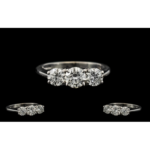 42 - 18ct White Gold Superb Quality and Attractive 3 Stone Diamond Ring. Fully Hallmarked for 18ct. The R...