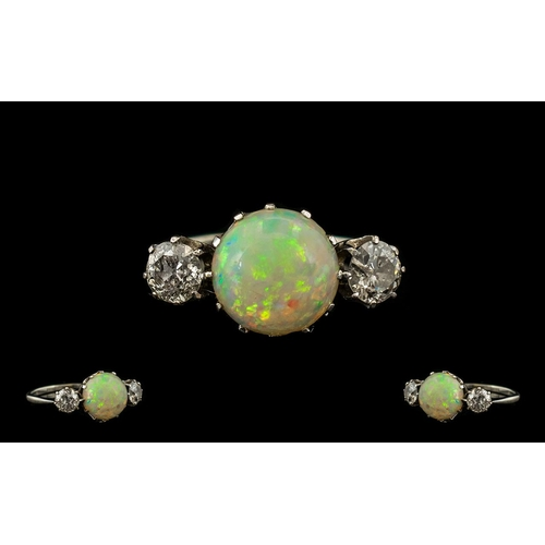 11 - 18ct White Gold Nice Quality & Attractive 3 Stone Opal & Diamond Dress Ring.  Raised gallery setting...