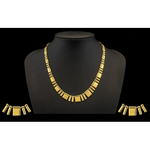 21 - A Top Quality Made Ladies 9ct Polished Gold Necklace - of wonderful form and design. Hangs smoothly ...