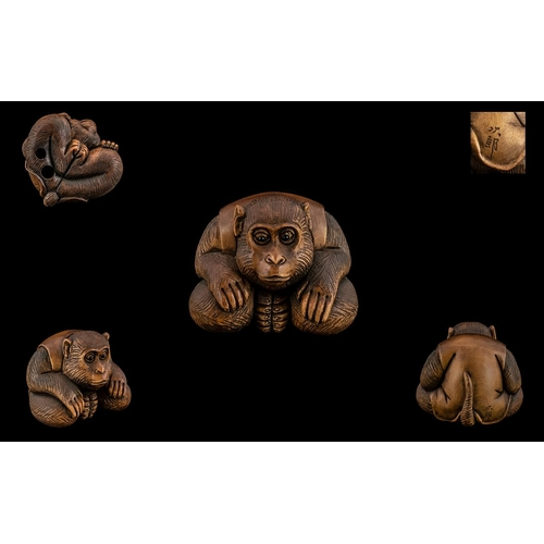 27 - Japanese - Fine Quality and Signed Carved Boxwood Netsuke Meiji Period 1864 - 1912. A ' Crouching Mo...