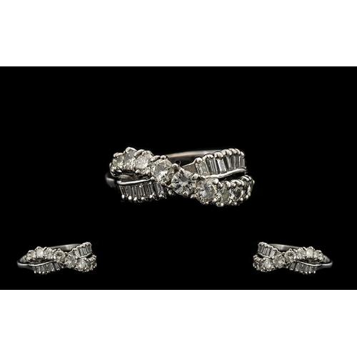 31 - 18ct White Gold Contemporary Nice Quality Baguette & Brilliant Cut Diamond Set Dress Ring.  The roun...