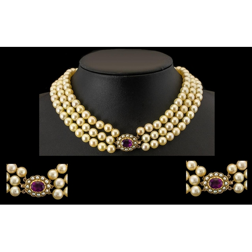 45 - Antique Period Fine Quality and Impressive Three Strand Cultured Pearl Necklace featuring a 9ct gold...