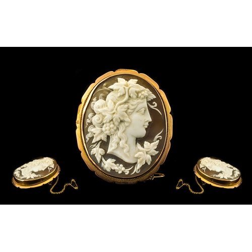 51 - Early 20th Century Impressive 9ct Gold Mounted Cameo Brooch with safety chain, of oval form.  The go...