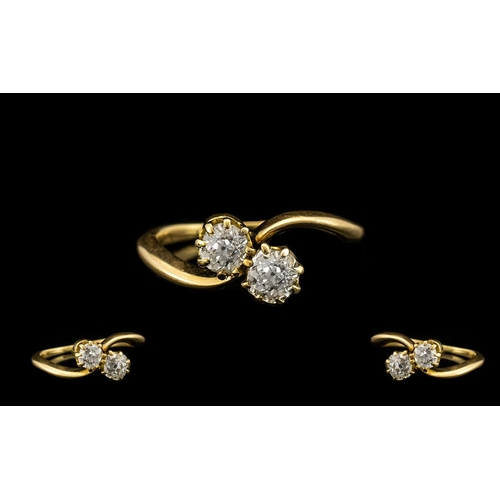 52 - Ladies Nice Quality 18ct Gold Two Stone Diamond Set Twist Ring circa 1930's. The old round brilliant...