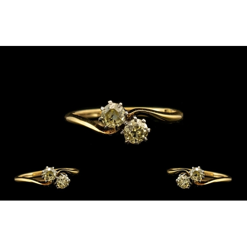 53 - Ladies 1920's Attractive Two Stone Diamond Set Ring Marked 18ct. The old round cut diamond of good c...