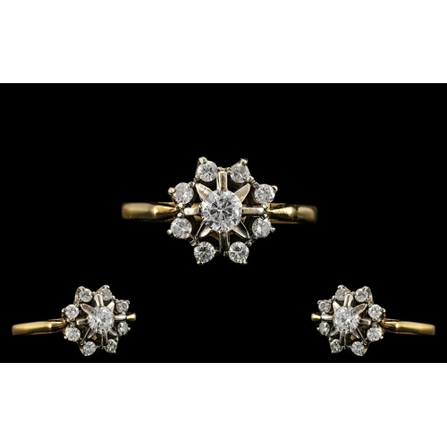 21A - 18ct Gold and Platinum Attractive Diamond Set Cluster Ring of Pleasing Design. The Larger Central Di...