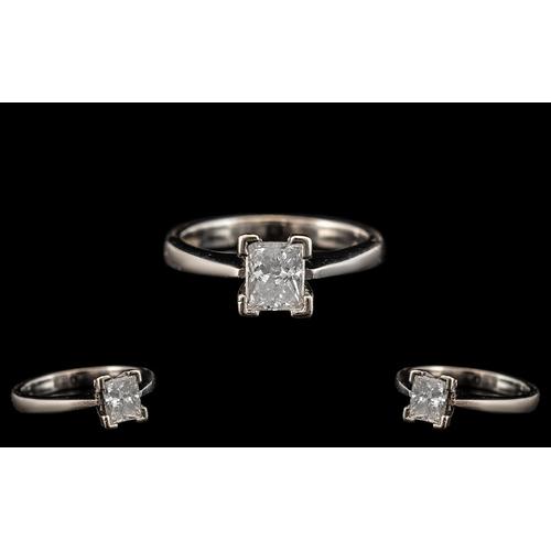 37 - Platinum Single Stone Diamond Set Ring of Contemporary Design. The Princes Cut Diamond of Top Colour...