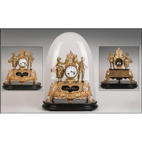 1116 - Antique French Gilt Metal Mantle Clock under a glass dome.  The central clock flanked by a loving co...