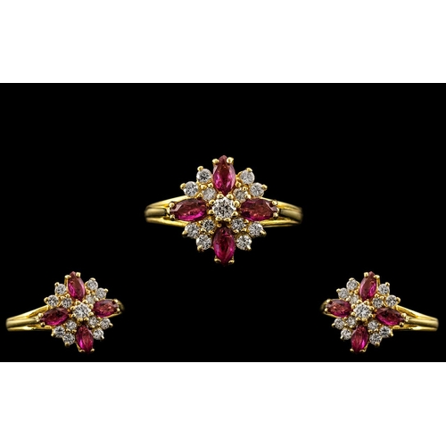 9 - 18ct Gold - Ladies Attractive Diamond and Ruby Set Ring In a Flower head Setting. The 4 Rubies with ...