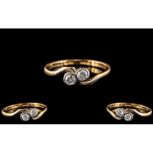 23 - 18ct Gold and Platinum - Attractive Two Stone Diamond Set Ring. Marked 18ct Gold and Platinum to Int...