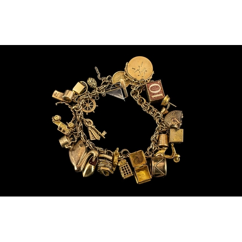 36 - Ladies - Excellent 9ct Gold Charm Bracelet Loaded with 25 9ct Gold Charms. Full Hallmark to All Char...