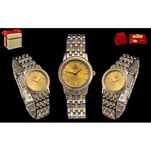 40 - Omega - Ladies 18ct Gold and Steel Diamond Set Wrist Watch. Features a Champagne Dial, Set with Diam...