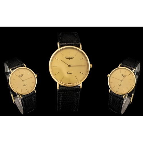 45 - Gentleman's 9ct Gold Longines Wrist Watch, 32mm diameter 9ct gold case, champagne dial with baton nu...