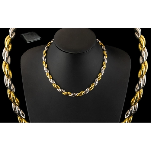 8 - A Stunning Italian 18ct Two Tone Gold Necklace In An Attractive Design with Concealed Clasp. In As N...