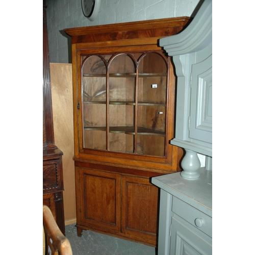 93 - Glazed corner cabinet...