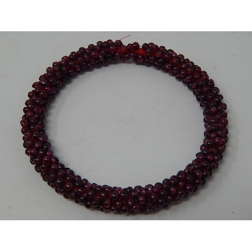 13 - Garnet Bead Necklace, length 70cm together with a Garnet Bead Bangle a/f....