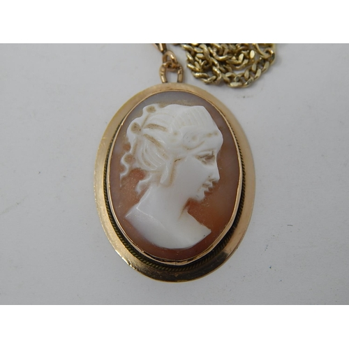 18 - A Gold Fine Flat Curb Link Chain with Cameo Pendant together with a pair of similar earrings....