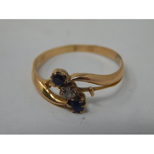 21 - Antique 18ct Gold Ring Inset with a central diamond & flanked by two sapphires. Ring size L....