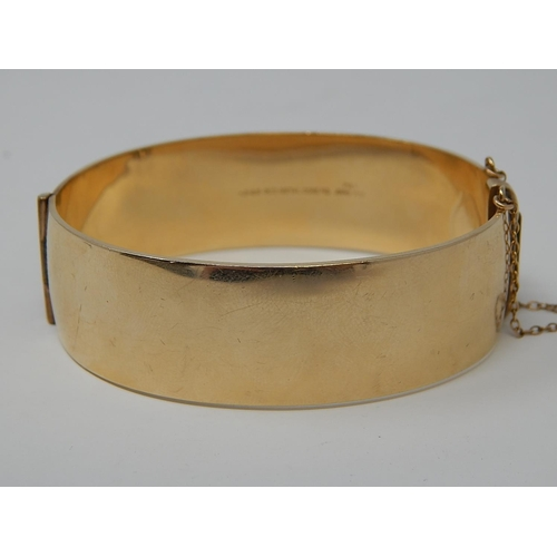 39 - 9ct Gold Metal Core Bangle with Safety Chain....