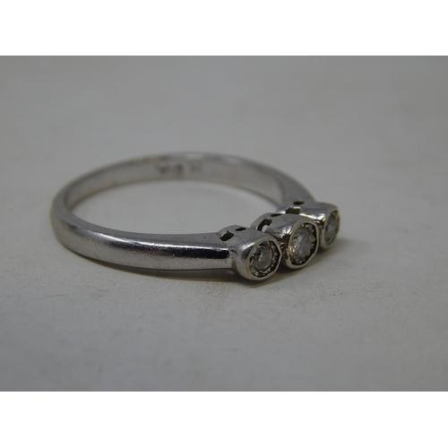 57 - 9ct white gold three stone diamond ring 0.25ct, size O....