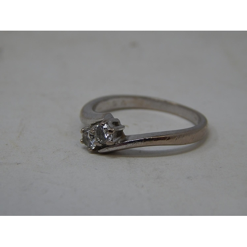 58 - 18ct white gold diamond two stone ring 0.25ct, size L....