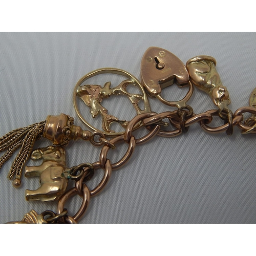 301 - 9ct Gold Charm Bracelet Containing Various Charms: Gross Weight 41.7g