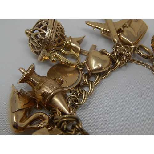 334 - Heavy 9ct Gold Charm Bracelet with 22 Charms: Gross Weight 67.8g