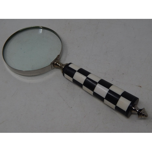 Large Magnifying Glass with Chequered Handle.