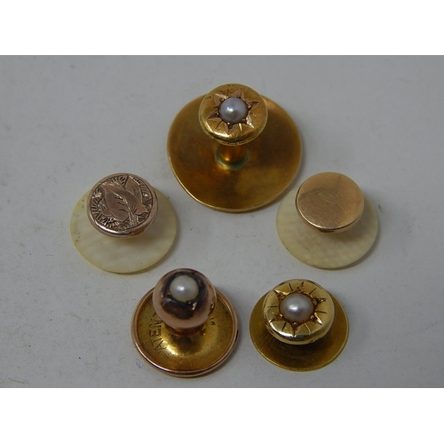 A pair of 15ct gold front & back collar studs set with a seed pearl, another in 9ct gold and two further gold-fronted and bone-backed – gross weight 3.2 15k – 1.9g, 9k, 0.7g.