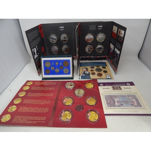 War Poppy Collection in 2 x folders; UK 1922 Coin set in case; 1952-2012 Queen's Diamond Jubilee Coin Collection; King George VI coin, stamp and banknote set; Queen Elizabeth II Part Set Proof coinage from Windsor Mint (lot)