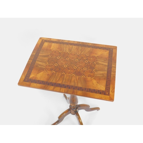 13 - A Victorian walnut and specimen wood rectangular topped occasional table, decorated centrally with f...
