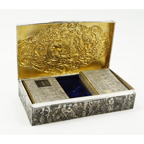 21 - An Edward VII silver games box, of rectangular form, opening to reveal a fitted interior with two pa...