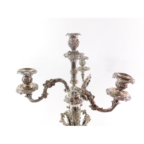 14 - An impressive 19thC Sheffield plate candelabra, with three detachable upper branches, raised on a se...