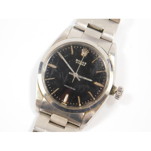 15 - A Rolex Oyster Precision gentleman's stainless steel cased wristwatch, circular black dial set with ...