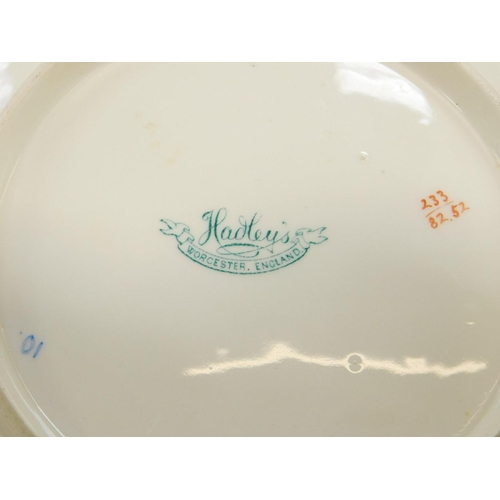 25 - A pair of Hadley's Worcester porcelain dessert plates, circa 1905, of trefoil form, painted with fru...