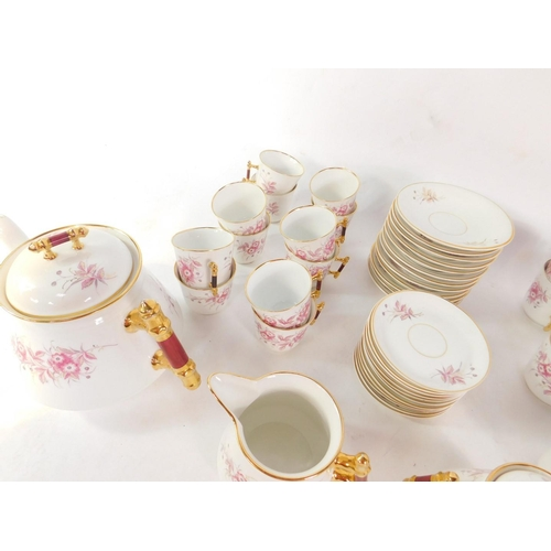 38 - An Altwasser porcelain tea and coffee service, decorated with floral sprays, comprising a teapot, co...