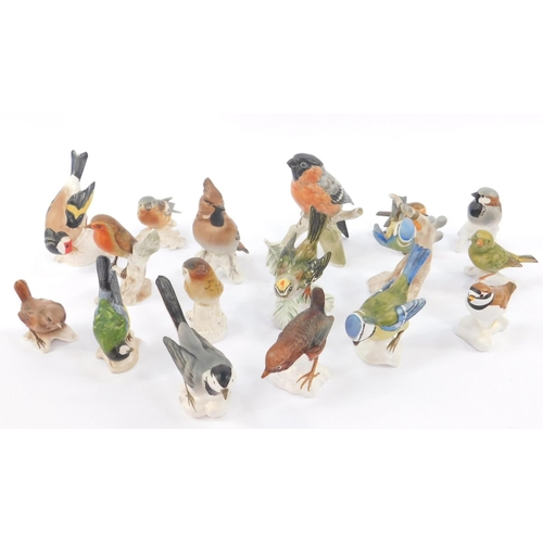 40 - A group of Goebbel pottery figures of birds, including a Bullfinch, Goldfinch, Greenfinch, and Robin...